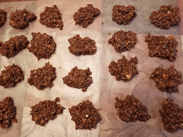 sugar, milk, butter, cocoa powder, salt, quick-cooking rolled oats, vanilla extract, walnuts, sweetened coconut