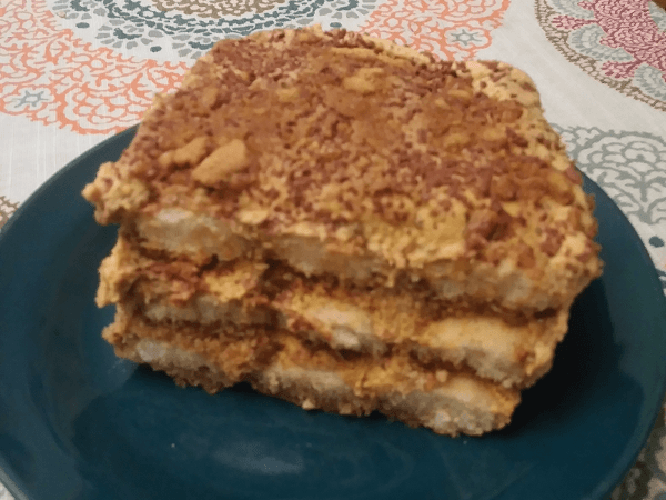 eggs, egg yolks, sugar, bourbon, mascarpone cheese, pumpkin puree, heavy cream, whipping cream, brown sugar, vanilla extract, cinnamon, instant espresso, nutmeg, ladyfingers, semisweet chocolate, ginger snaps