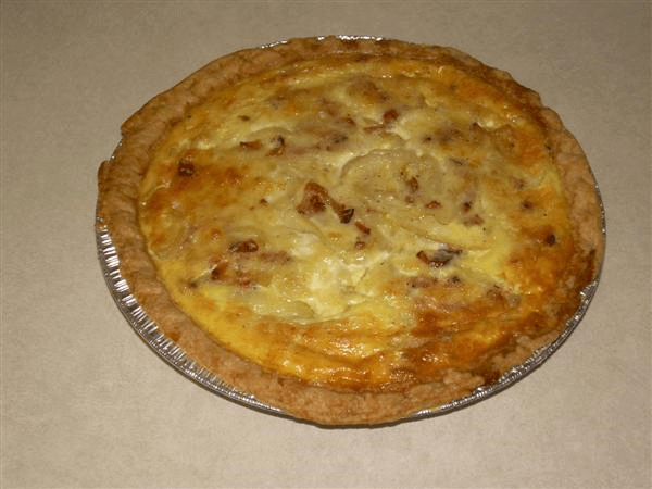 frozen pie crusts, eggs, whole milk, salt, black pepper, nutmeg, Gruyere cheese, all-purpose flour, center-cut bacon, center cut bacon, sweet onions