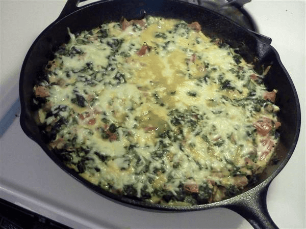 boneless skinless chicken breasts, olive oil, eggs, salt, black pepper, parsley, onion, mushrooms, frozen chopped spinach, tomatoes, Mozzarella cheese