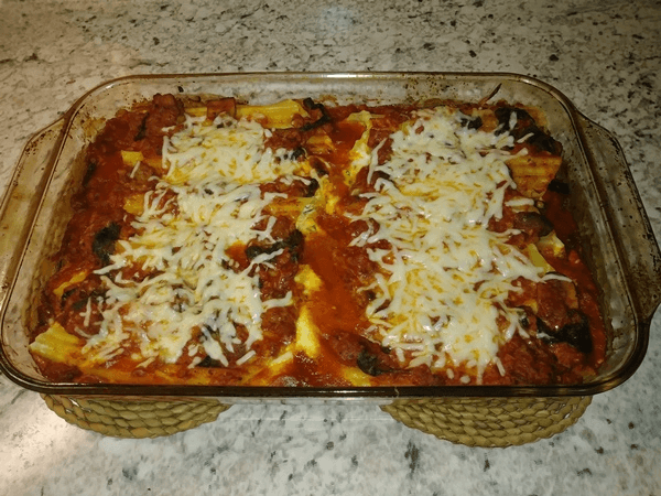 sweet Italian sausage, mild Italian sausage, white wine, crimini mushrooms, crimini mushrooms, garlic, spinach, pasta sauce, manicotti pasta shells, part-skim ricotta, eggs, parsley, kosher salt, black pepper, Parmesan cheese, part-skim mozzarella cheese