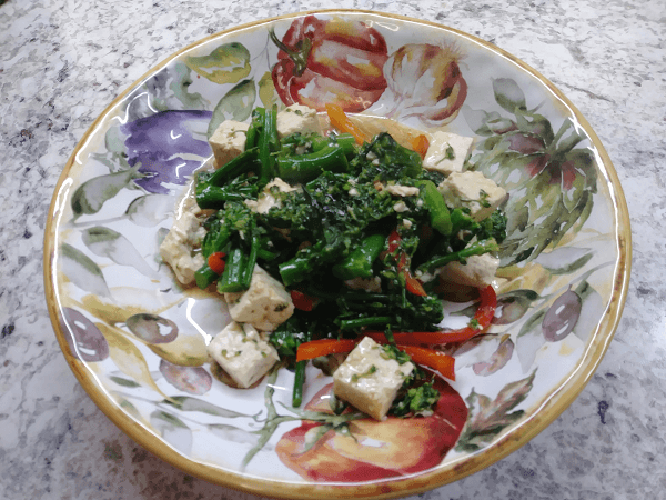 Broccolini, vegetable broth, vegetable stock, soy sauce, mirin, ginger, cornstarch, hot sesame oil, garlic, canola oil, red bell peppers, extra firm tofu, almonds